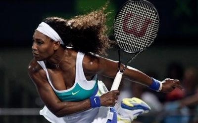 Serena Williams of the U.S. follows through on a serve to Japan's Ayumi Morita in their women's singles third round match at the Sony Open tennis tournament in Key Biscayne, Florida March 23, 2013. REUTERS/Andrew Innerarity