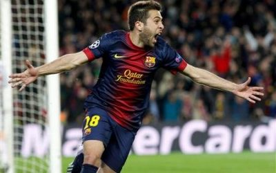 Barcelona's Jordi Alba celebrates after scoring a goal against AC Milan during their Champions League round of 16 second leg soccer match at Camp Nou stadium in Barcelona March 12, 2013. REUTERS/Gustau Nacarino