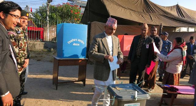 Chairman of Interim Election Council (IEC) Khil Raj Regmi casts his vote at a polling centre at New Baneshwor in Kathmandu on Tuesday' November 19' 2013. Photo: RSS